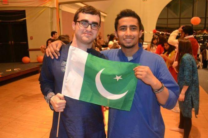 Senior John Bieniek (left) and freshman Sarim Rahim (right) displaying the Pakistani flag.