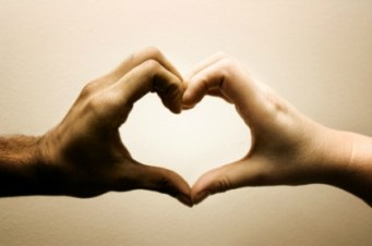 Two hands creating a heart