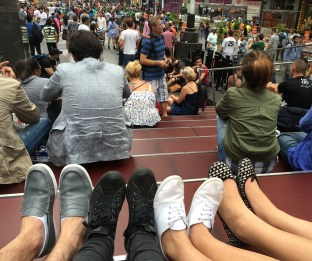 Students taking a break on the TKTS stairs at Time Square