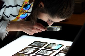 Inspecting our colour and monochrome glass lantern slides © Nathan Stazicker