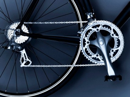 Close up of bicycle chain, pedal and gears