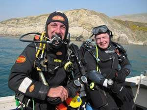 smiling divers on our club boat