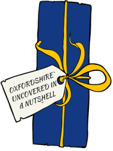 """Blue present with label """"Oxfordshire Uncovered in a nutshell"""""""