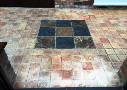 Grubby Terracotta and Slate Conservatory Floor Bicester Before Cleaning