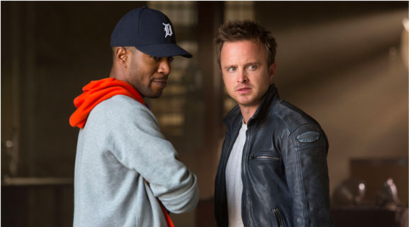 Kid Cudi and Aaron Paul in Need for Speed.