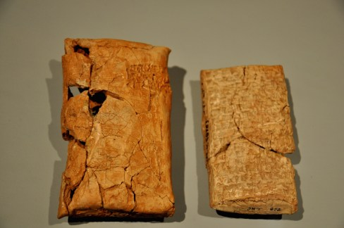 World History: A commercial letter (clay tablet) enclosed by an envelope (a clay covering). The letter was supposed to be opened by the recipient. 2nd millennium BCE, Mesopotamia, Iraq. (The Sulaimaniya Museum, Iraq).
