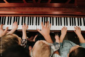 Different sized hands on the piano keys