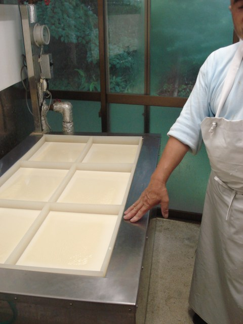 The shallow basins where he boils the soy-milk for yuba