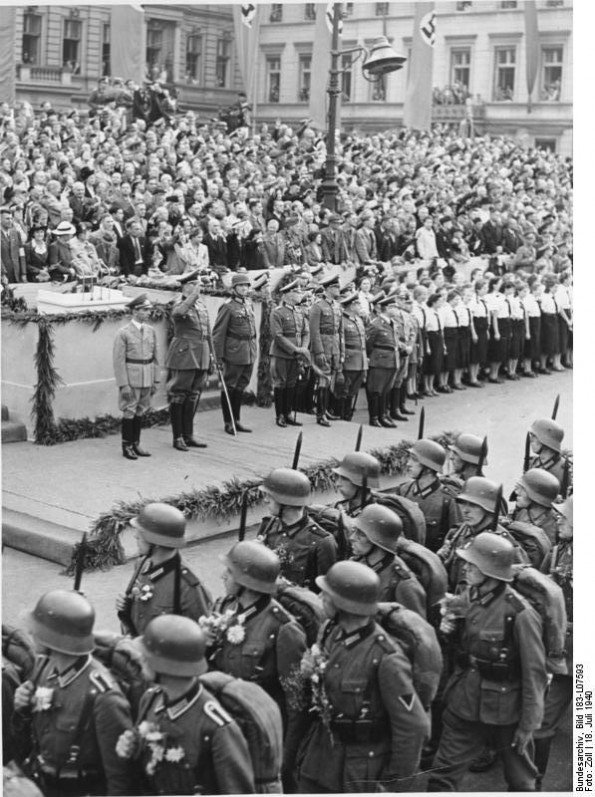 Germans celebrate their victorious soldiers with huge military parades- & hear Goebbels promise that after one more battle, they will enjoy peace.