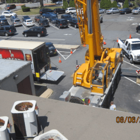 Challenging safe removal from room with use of a crane