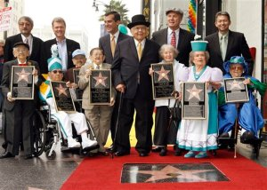 """Honorary Mayor of Hollywood, Johnny Grant, center with hat, honors The Munchkins from """"The Wizard of Oz"""" as they receive a star on the Hollywood Walk of Fame at Grauman's Chinese Theatre, site of """"The Wizard of Oz's"""" 1939 premiere, in Los Angeles Tuesday, Nov. 20, 2007. The Munchkins from left: Mickey Carroll, the Town Crier; Clarence Swensen, a Munchkin soldier, Jerry Maren, part of the Lollipop Guild; Karl Slover, the Main Trumpeter; Ruth Duccini, a Munchkin villager; Margaret Pelligrini, the """"sleepyhead"""" Munchkin and Meinhardt Raabe, the coroner. Back row from left: Ted Bulthaup, sponsor of the star and owner of a Trip to the Movies Theatre in Chicago, Los Angeles City Council President Eric Garcetti, Tom LaBonge, LA Councilman and Leron Gubler, President/CEO Chamber of Comerce. (AP Photo/Damian Dovarganes)"""