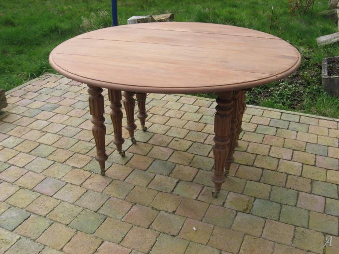 ancienne table ronde en acajou a 8