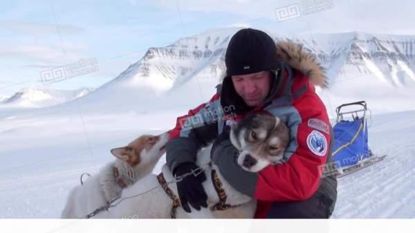 Man Base Of Dog Sled Team Husky Eskimo North Pole In