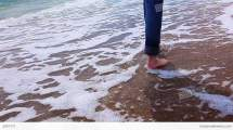 Slim Girl In Jeans Barefoot Beach Stock Video