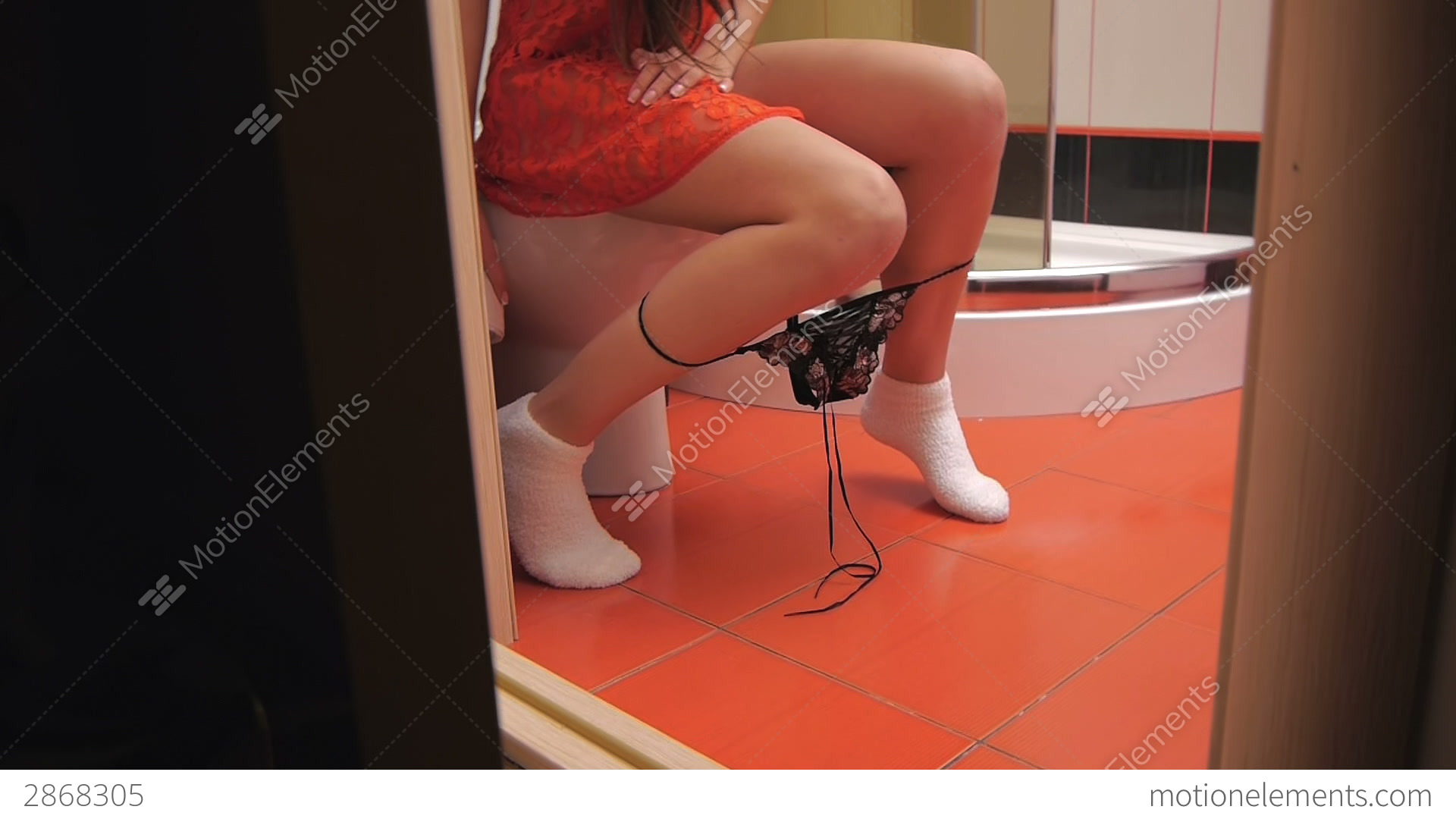 Girl Sitting On The Toilet In The Bathroom Stock video