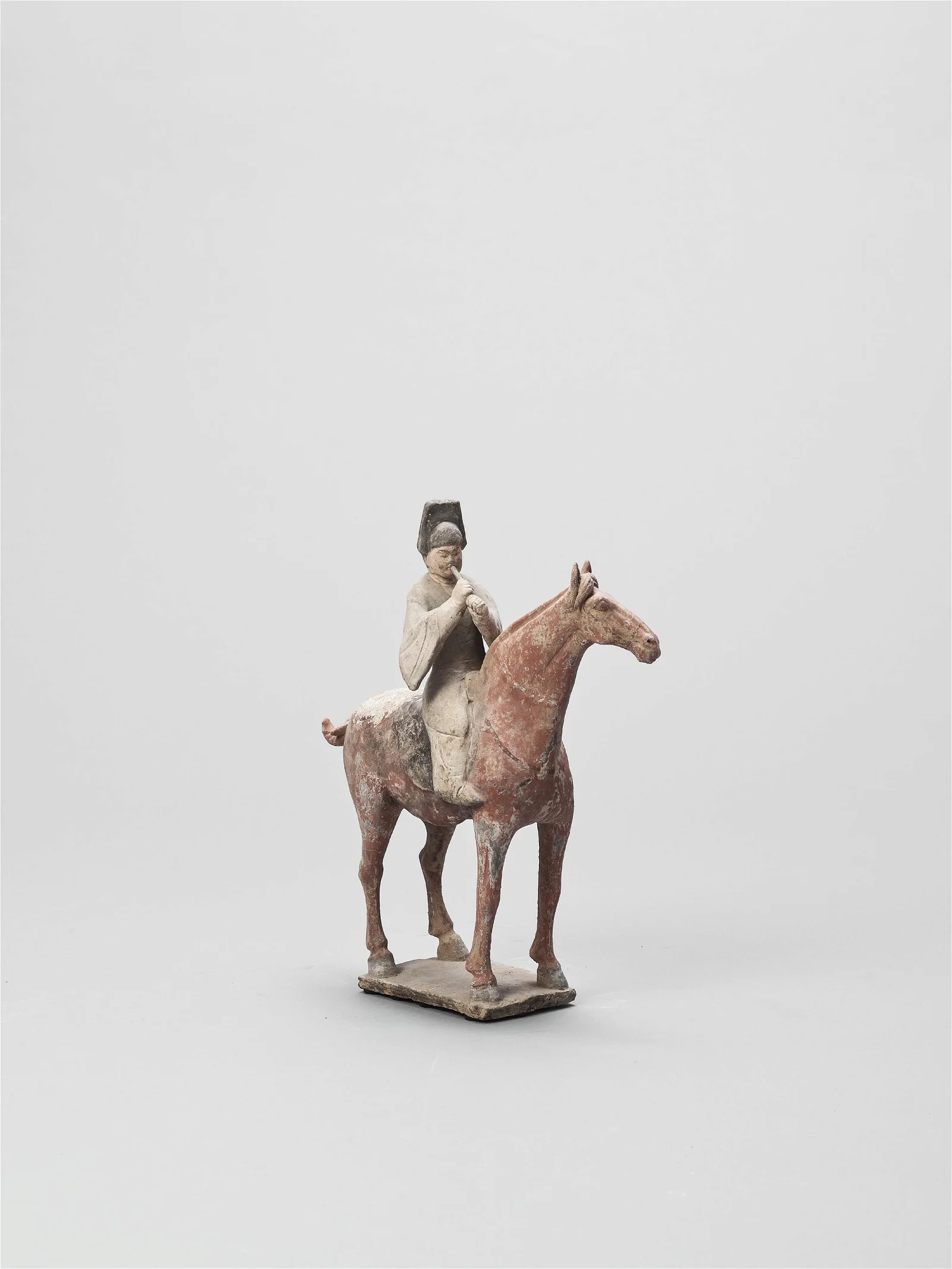 A COLD-PAINTED TERRACOTTA MODEL, TANG