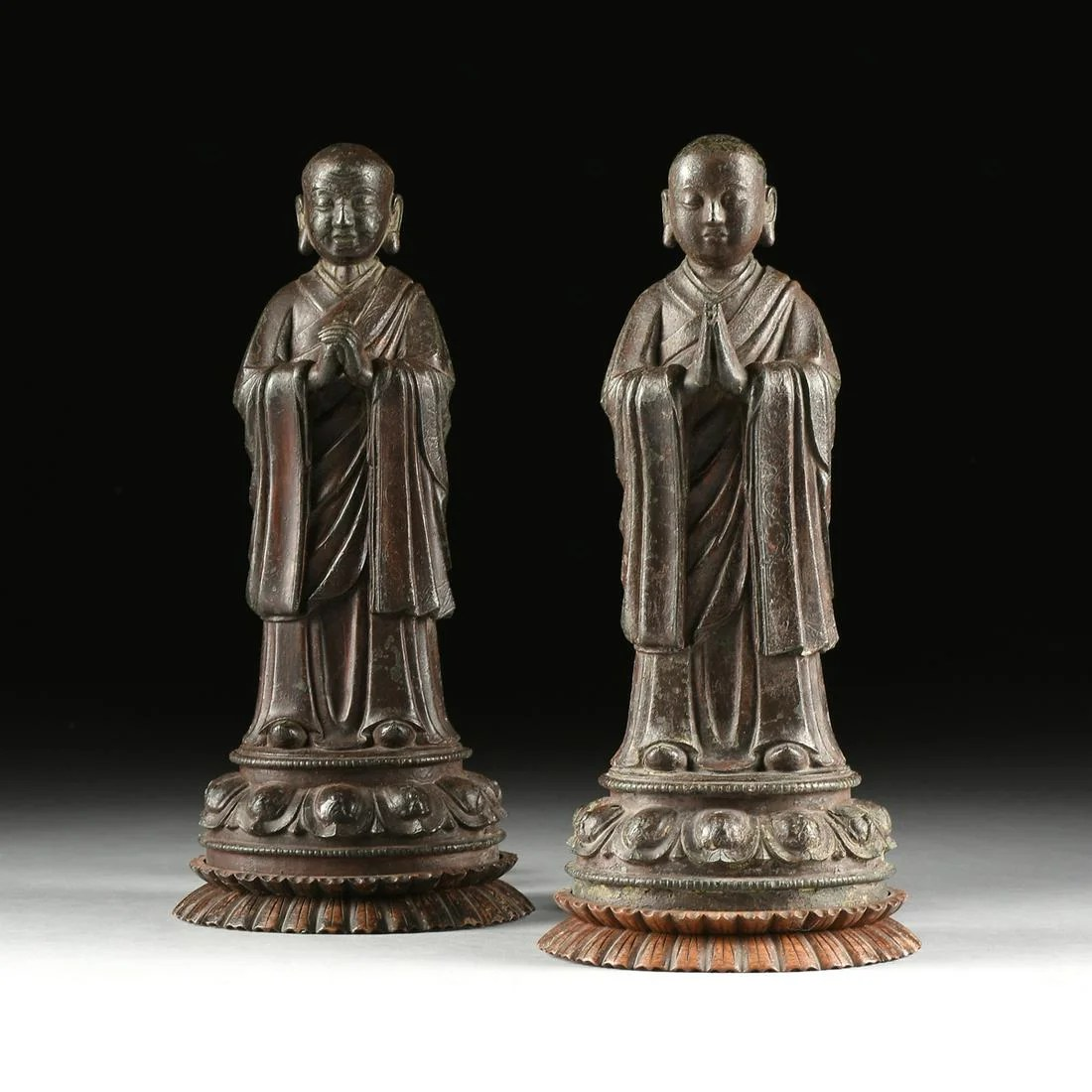 A PAIR OF MING DYNASTY STYLE ENAMELED BRONZE DISCIPLES