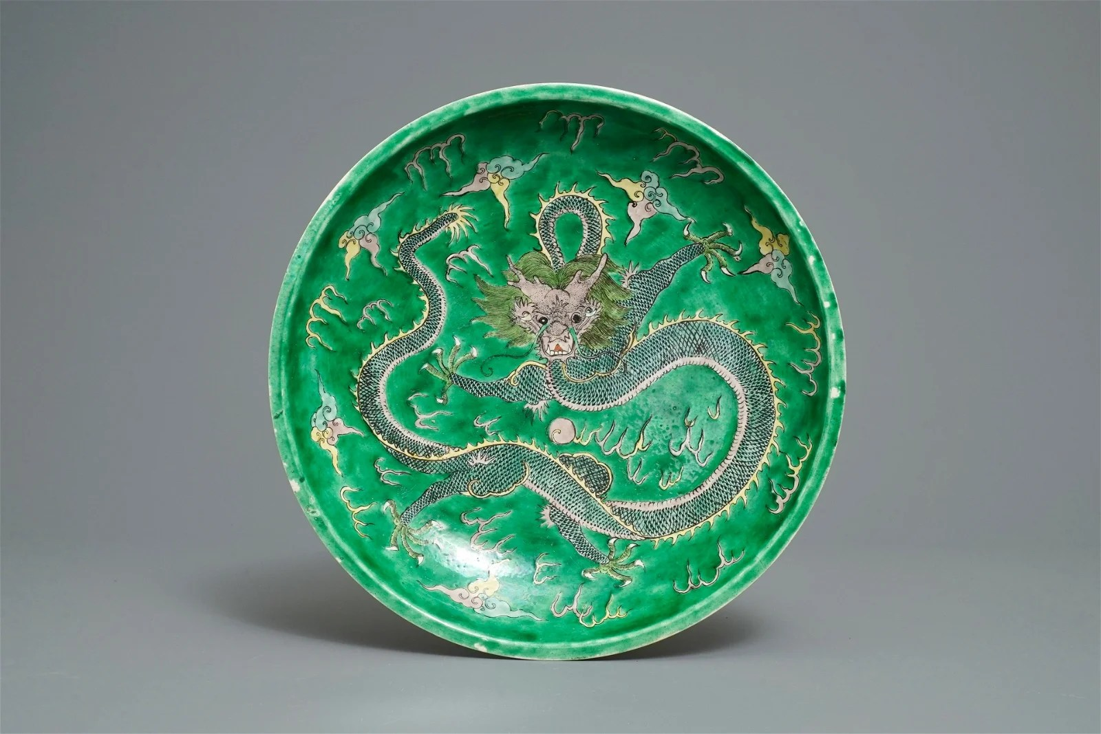 A Chinese verte biscuit 'dragon' charger, Kangxi mark,