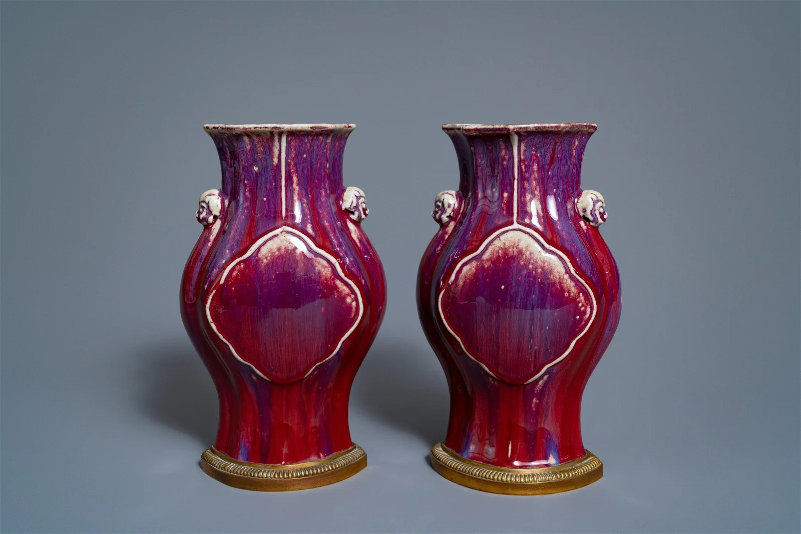 A pair of Chinese flambé vases on gilt bronze stands