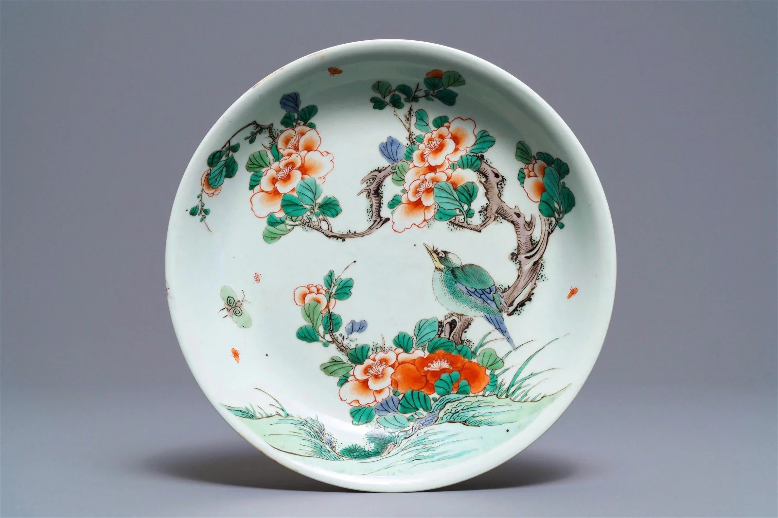 A Chinese famille verte dish with a bird on a flowery