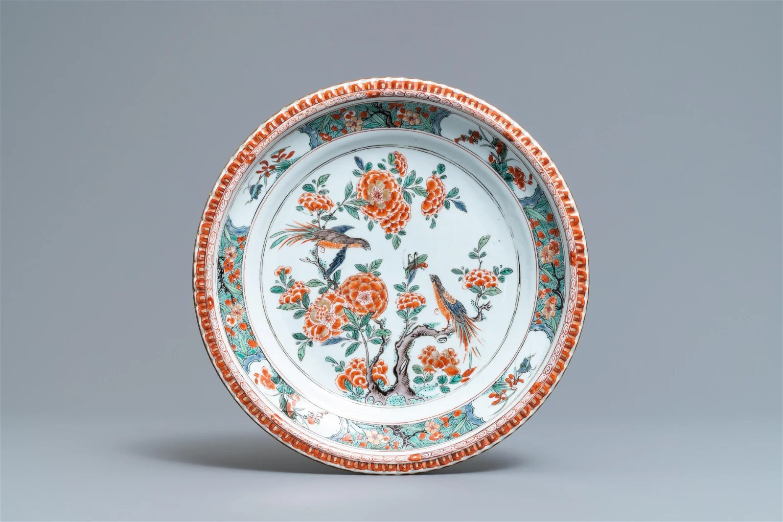 A Chinese famille verte dish with birds among blossoms,