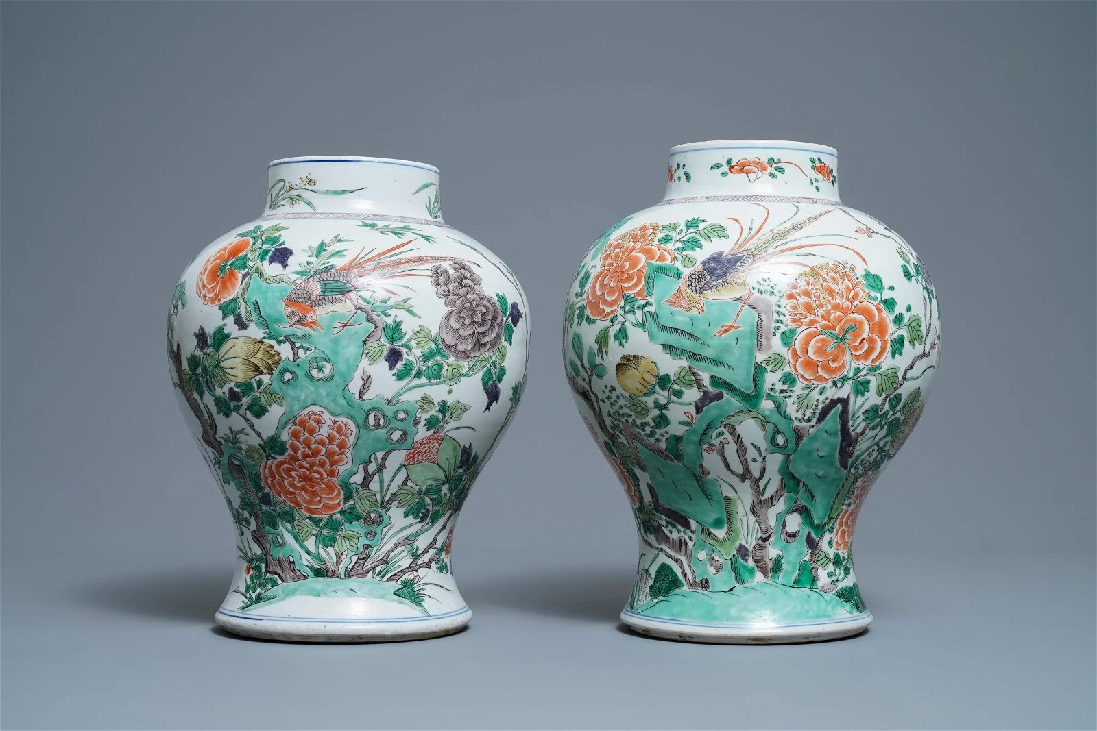 A pair of Chinese famille verte vases with birds and