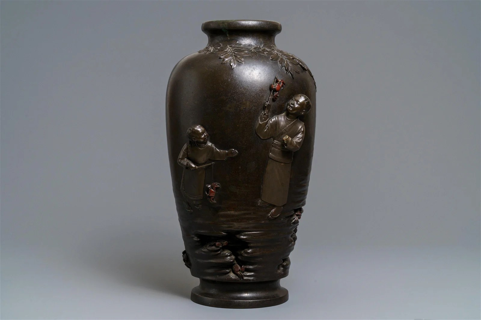 A large Japanese bronze vase with crab-fishing