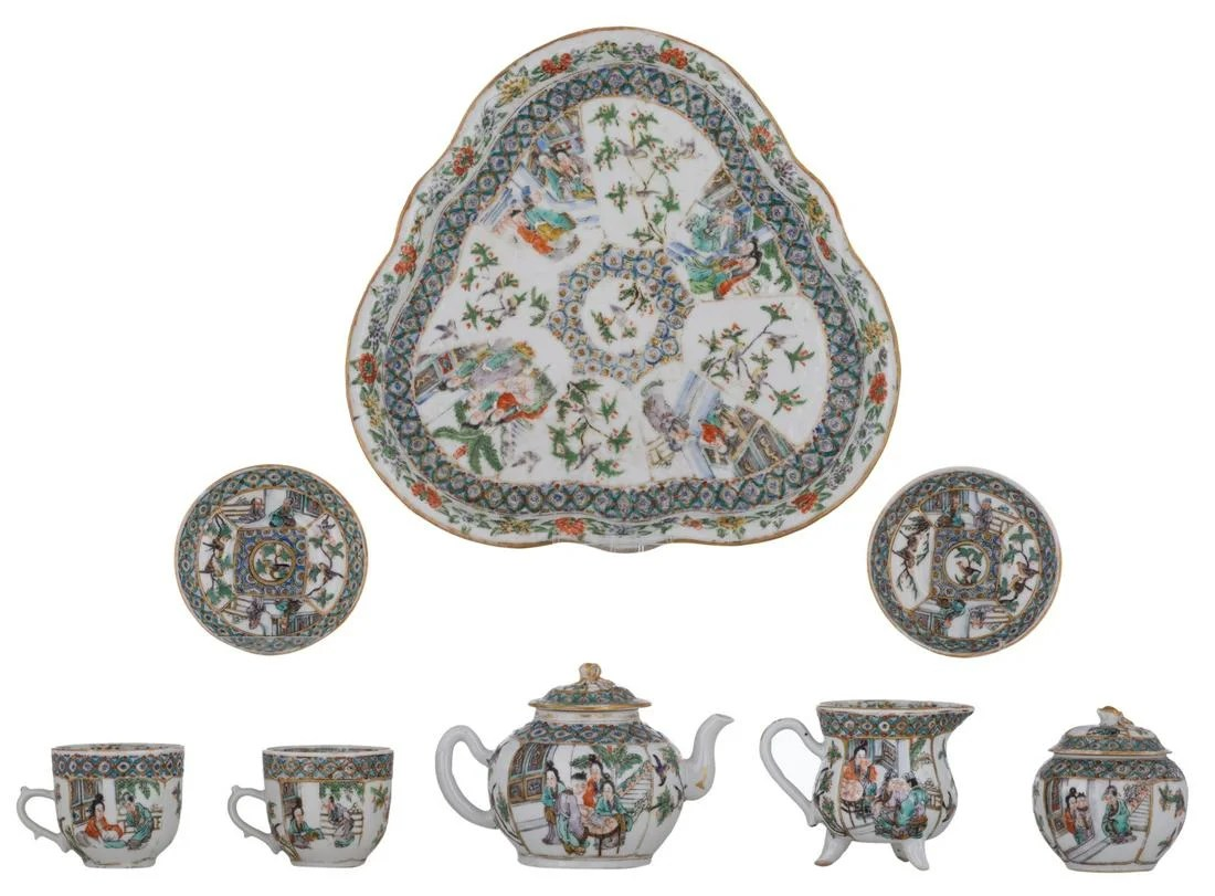 A Chinese famille verte tea set, a tea tray, two cups