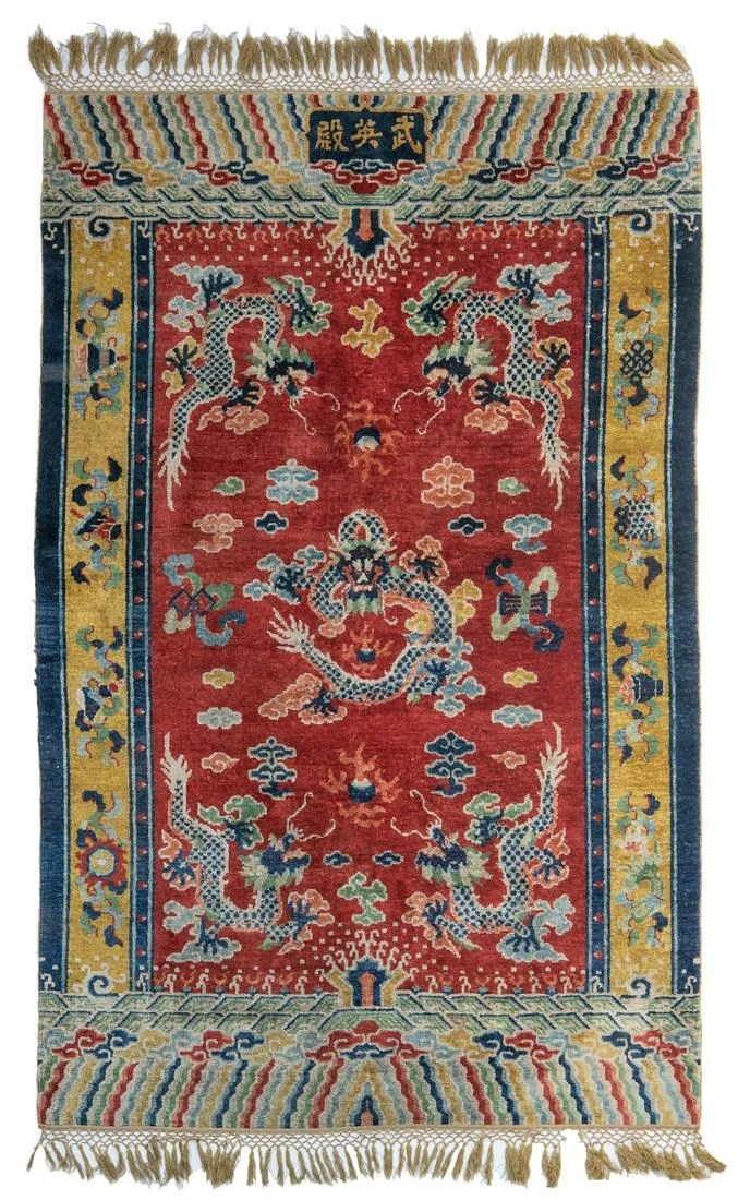 An imperial Chinese rug, decorated with five-clawed