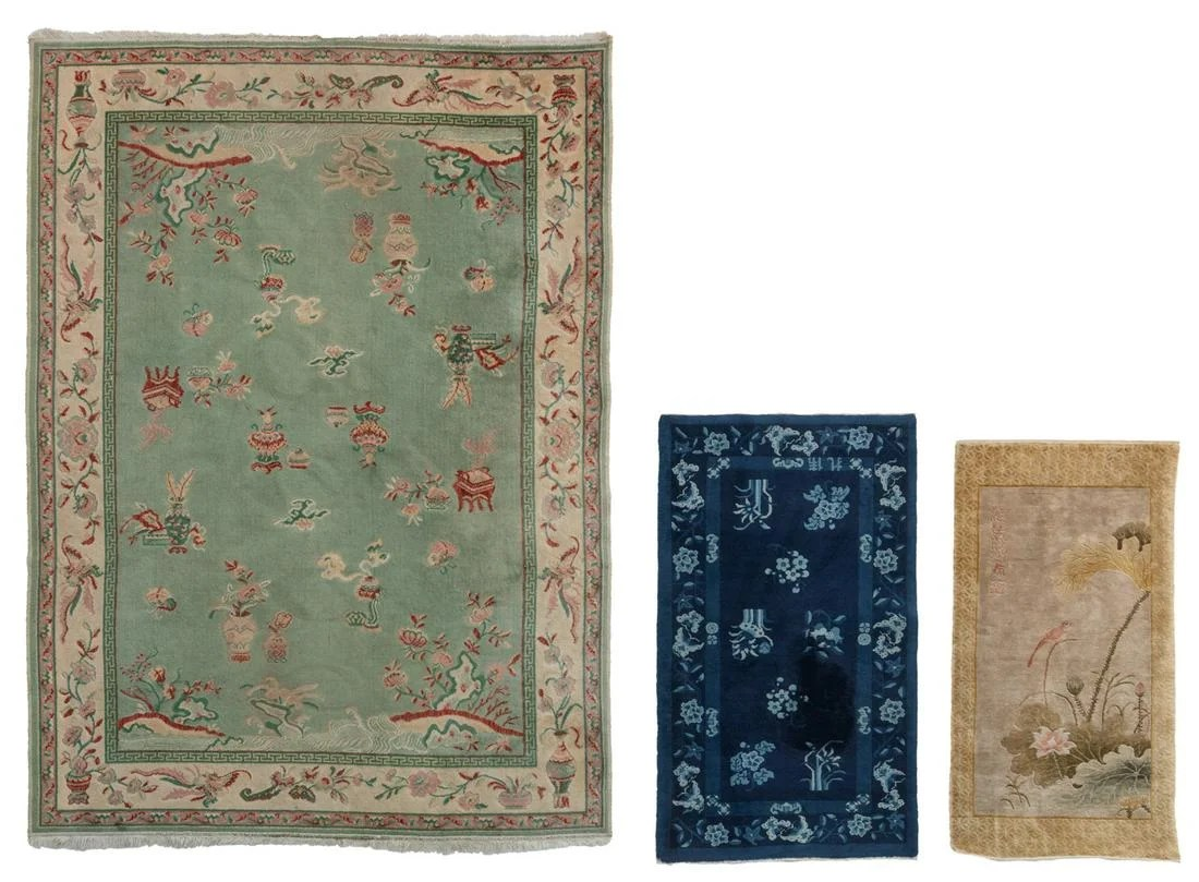 Three Chinese woollen rugs, one decorated with