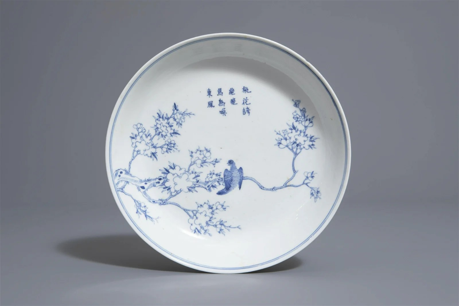 A Chinese blue and white plate with a bird on a branch,