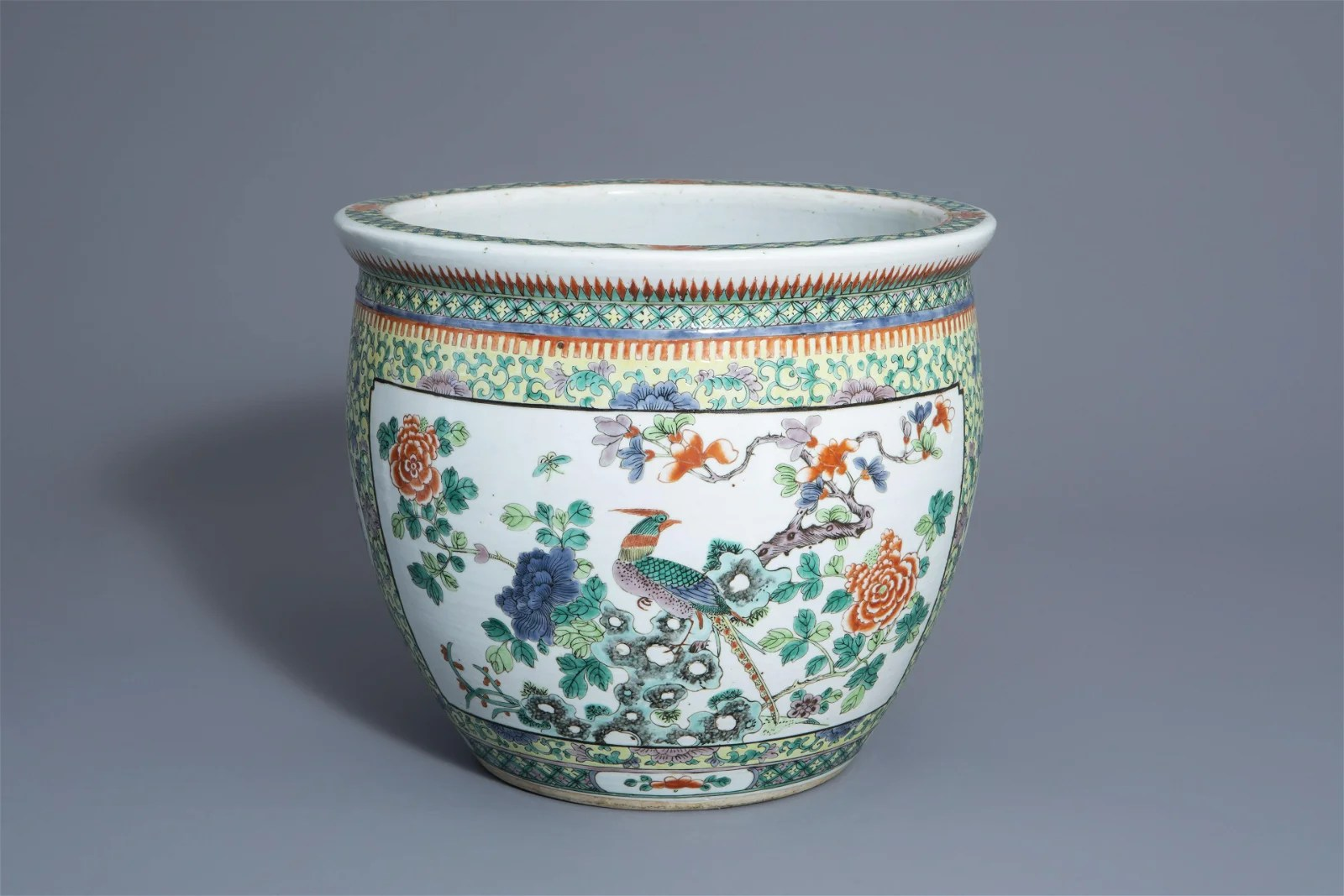 A Chinese famille verte fish bowl with a bird among
