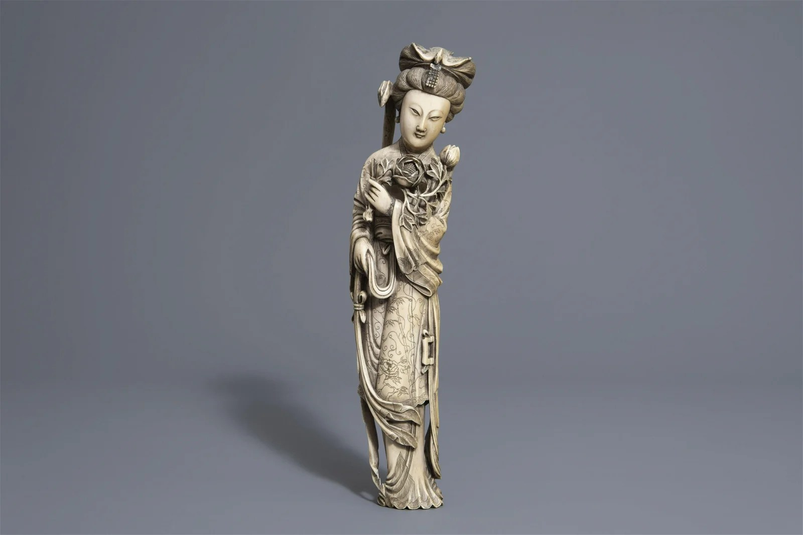 A Chinese figure of a lady with flowers, seal mark