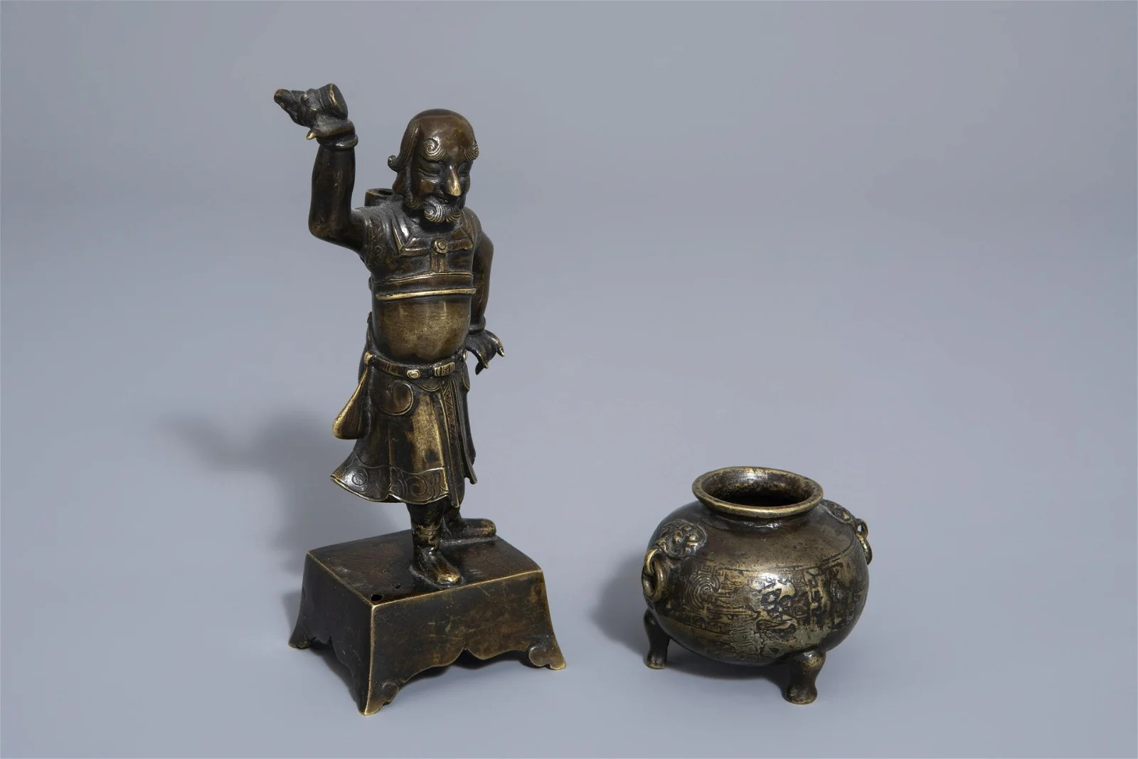 A Chinese bronze incense stick holder and a censer,