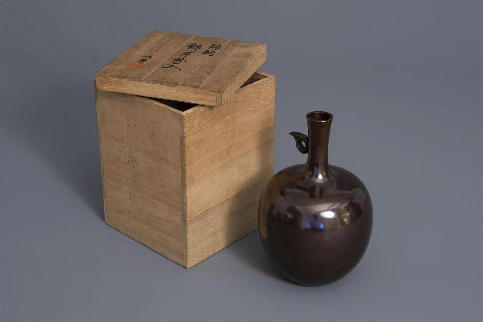 A stylized Japanese apple shaped bronze vase, Tsuda