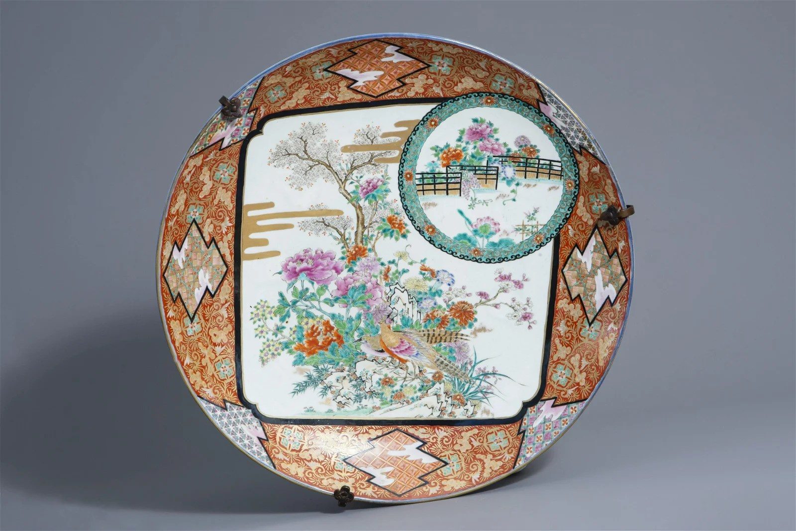 A large Japanese charger with birds on blossoming