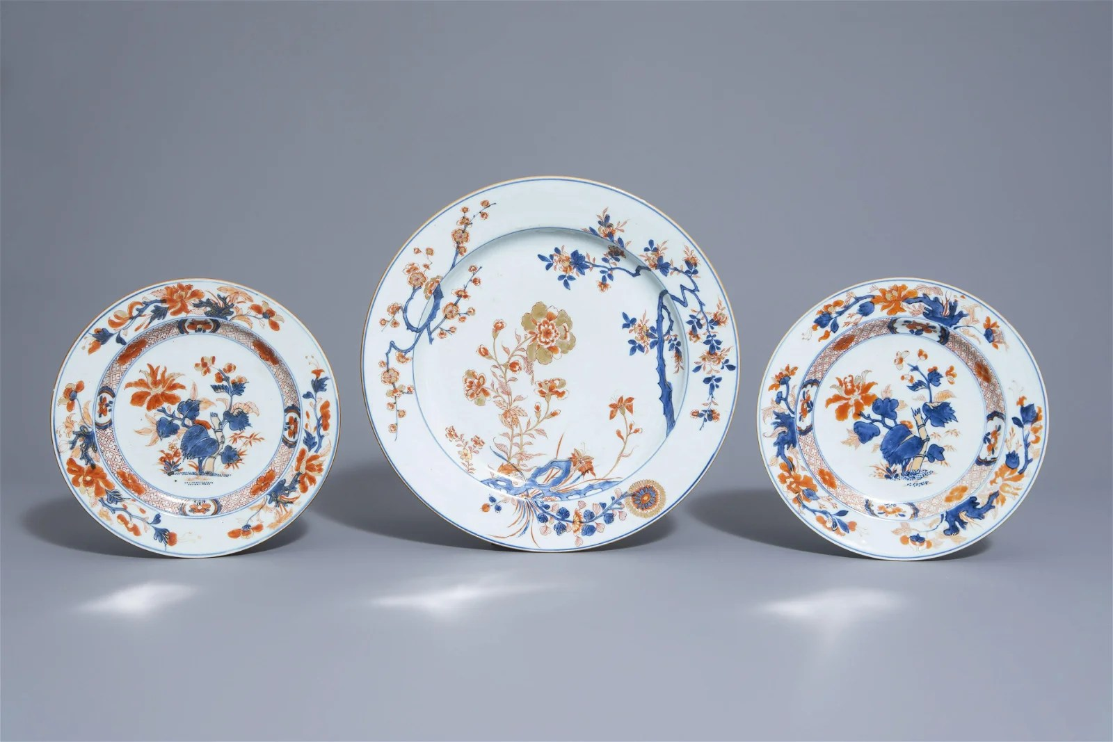 A Chinese Imari style charger and two plates with