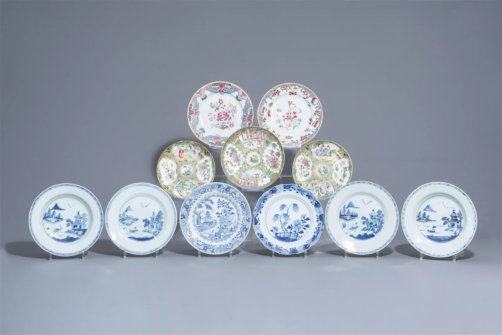 Eleven Chinese blue and white and famille rose plates,