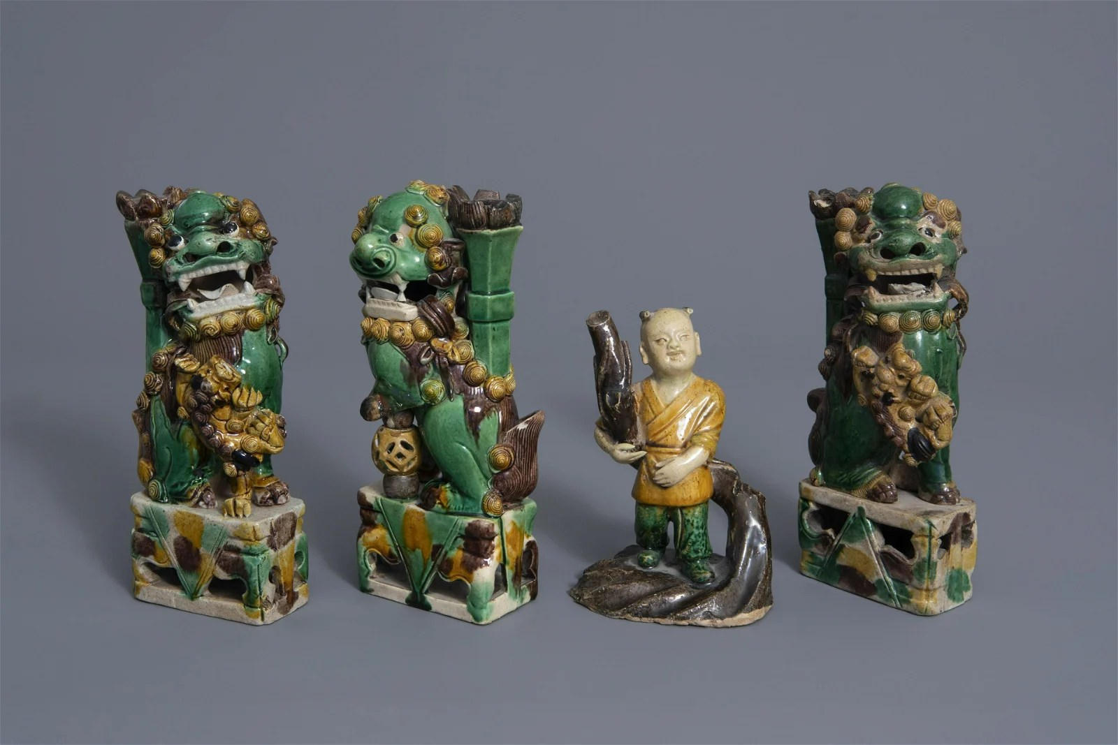 Three Chinese famille verte biscuit models of Buddhist