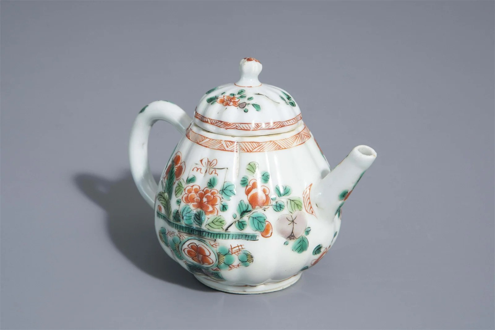 A Chinese famille verte teapot and cover with floral