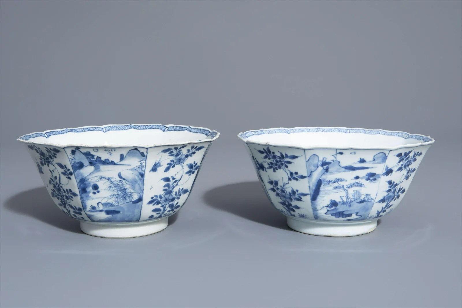 A pair of Chinese blue and white bowls with landscapes