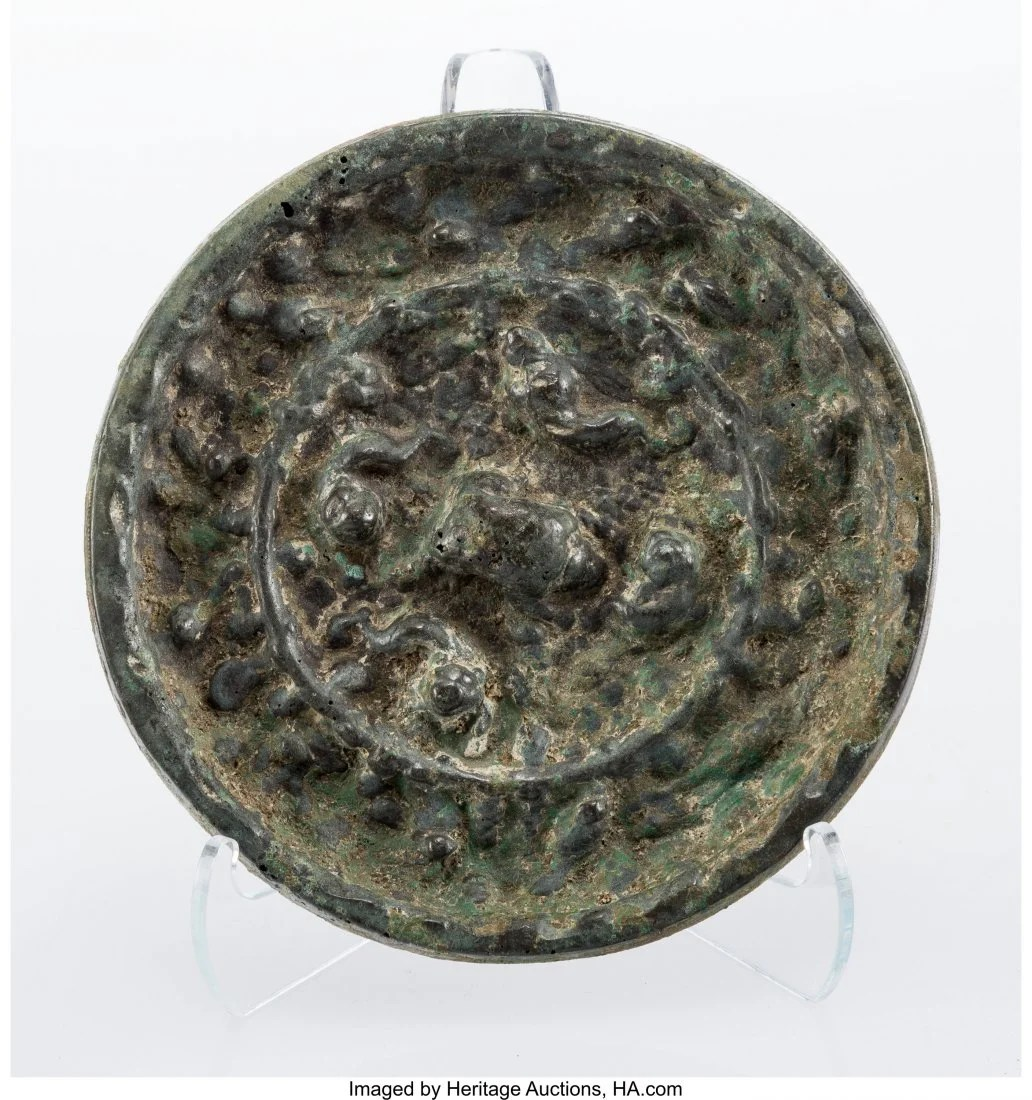 27064: A Chinese Bronze Mirror, Tang Dynasty 4-1/4 inc