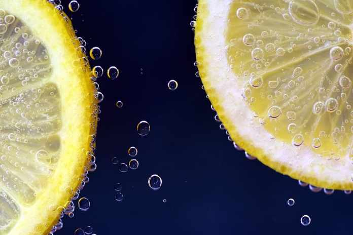 two sliced lemons, lemon, lemon under water, lemonade, drink ...