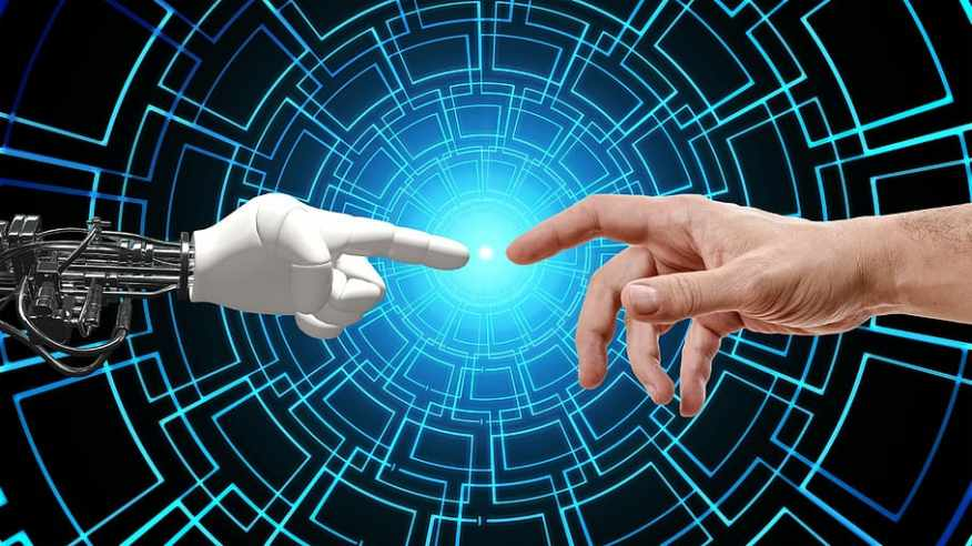 Robot and human hand pointing at each other