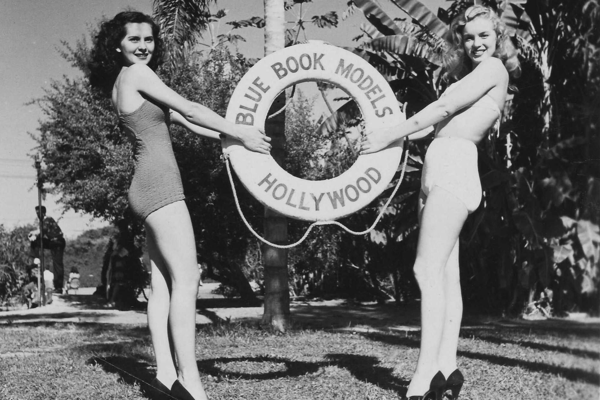 marilyn poses alongside another blue books models girl