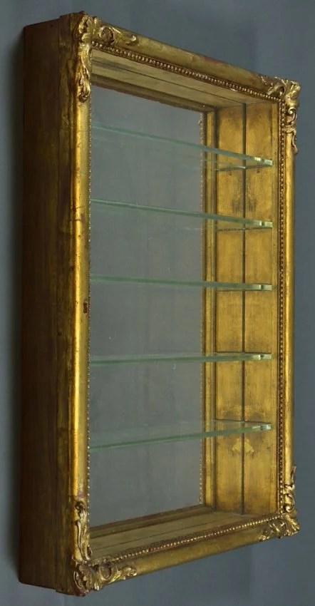 A VINTAGE GILTWOOD PERFUME CURIO DISPLAY WALL CABINET