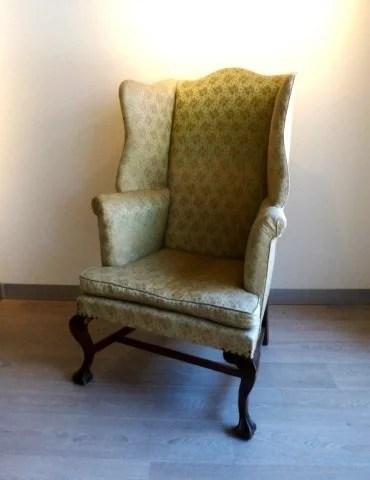 Oversized wingback chair on ball and claw feet  Lot 368A