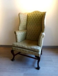 Oversized wingback chair on ball and claw feet : Lot 368A