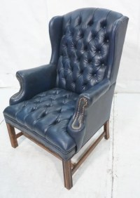 Navy Blue Leather Chesterfield style Wing Chair. : Lot 375