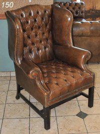 "150: BROWN LEATHER TUFTED WINGBACK CHAIR 44"" high : Lot 150"